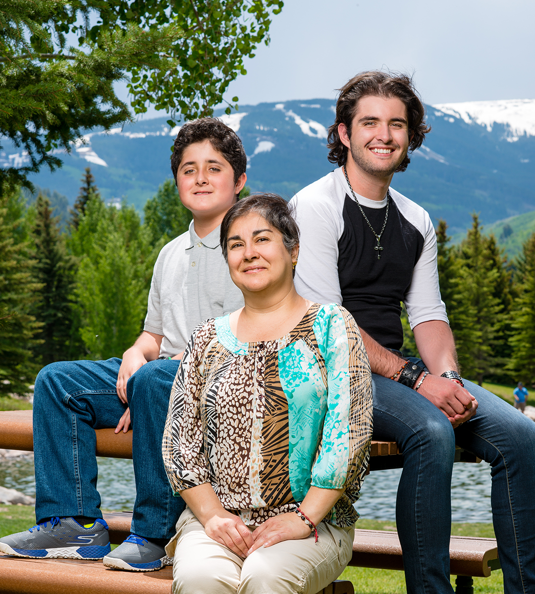 Maria Landeros Lopez with two sons sitting outside